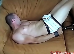 Young gay Cary restrained for feet tickled and handjob