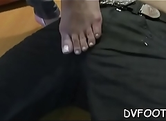 Gal plays sensually with her hot feet on feetdomvideos.com