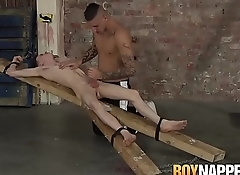 Candle waxed twink slave receives blowjob from his master