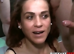 Gangbanged redhead devours a ton of rock solid cock