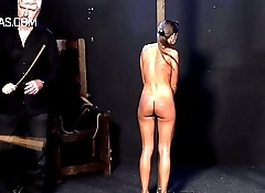 After brutal whipping both slaves are covered in marks