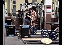 Couple Kissing in Gym